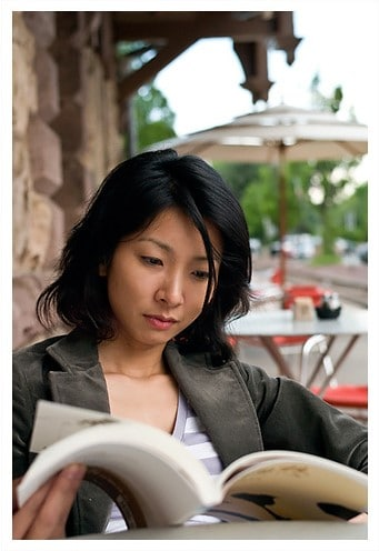 Woman reading book – Flickr – Photo Credit - pyl213